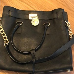 Michael Kors purse black and gold.